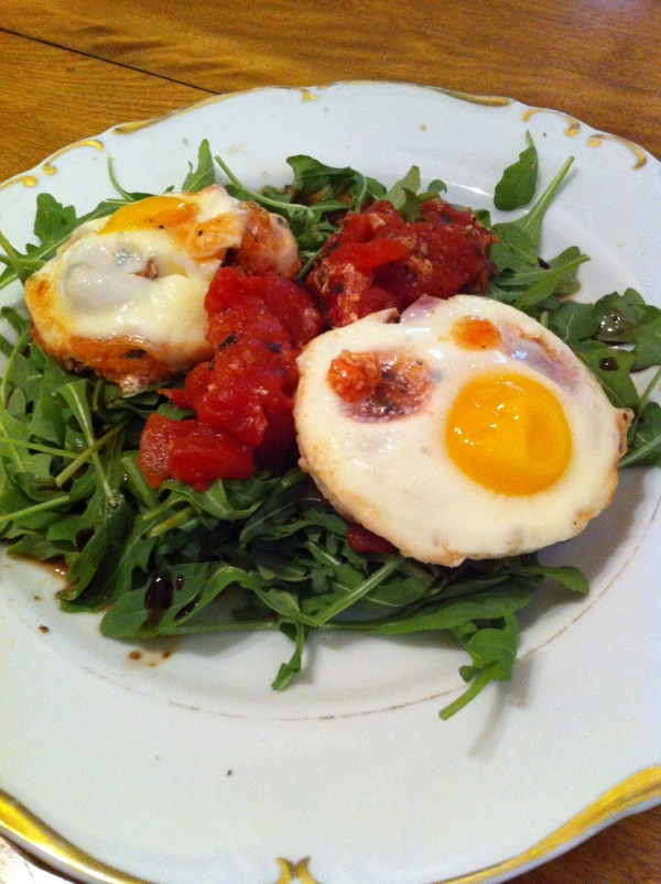 baked_eggs_over_arugula