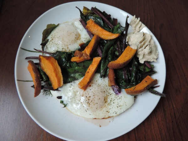 nestled_eggs_beet_greens